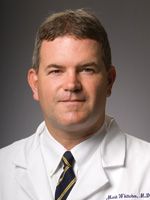 Mark E. Whitaker, MD